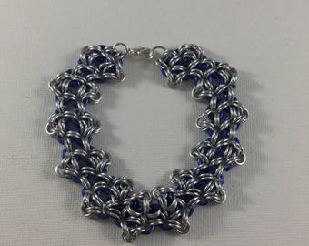 Blue and silver chainmail bracelet. This bracelet is made of blue and silver aluminium jump rings and silver plated lobster clasp