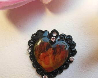 pretty black heart shaped charm