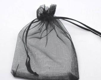 10 pouches or black organza bag. Size 7 x 9 cm.