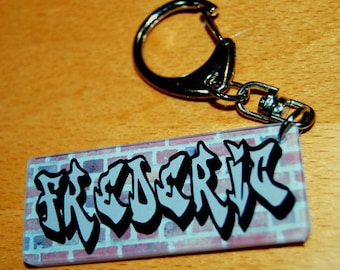 Key chain name of your choice of grey graffiti on brick wall background