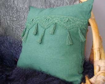 Green shabby pillow with old lace