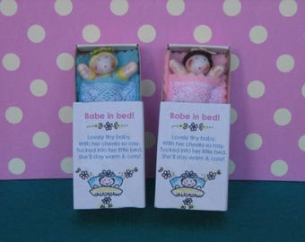 Pair of Baby dolls in bed, tiny doll in sleeping bag and Matchbox