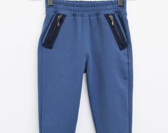 Blue trousers with zips