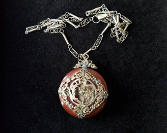 Beautiful nineteenth century carnelian pendant adorned with a Phoenix facing a dragon.