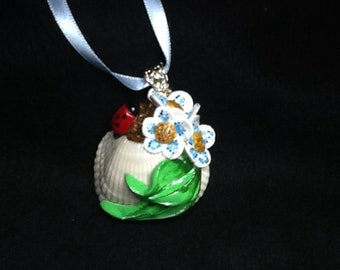 Natural shell with floral design pendant