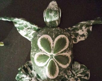 Sea turtles, hand made.with clay and sea shells from the ocean using a sand dollar (sea urchin) as the main body ,unique, one of a kind