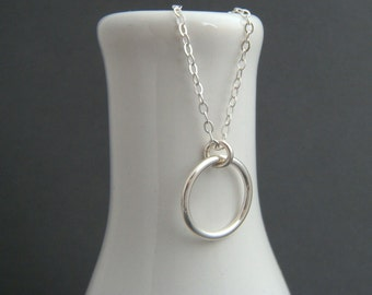"""silver ring necklace. large sterling silver circle. simple. modern. delicate. dainty. everyday. minimalist. zen jewelry. eternity. 1/2"""""""