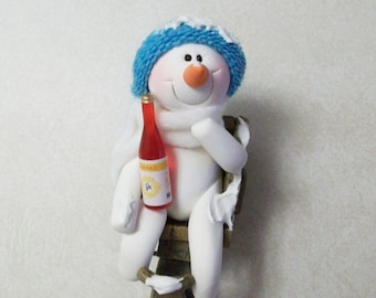 Jolly Snowman with Holiday cheer, snowman with bottle of wine, tipsy in a garden cart