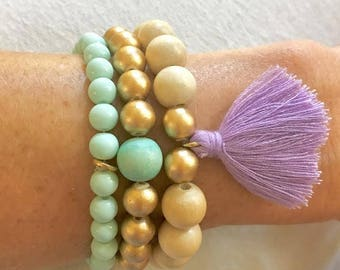 Natural, Gold, and Mint Wood and Glass Mix Beaded Bracelet Stack with Purple Tassel