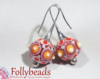 Handmade lampwork Artisan glass bead earrings, raked and raised dots in Red, Orange Pink and white.