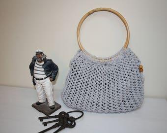 Hand knitted handbag with bamboo handles