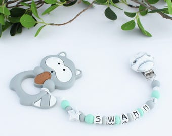 Teething-pacifier-clip 2 in 1 raccoon, personalized with baby's name, model SWANN, silicone beads