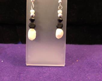 Black and white pearl drop earrings.