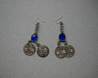 Blue glass and metal double dangle emblem earrings