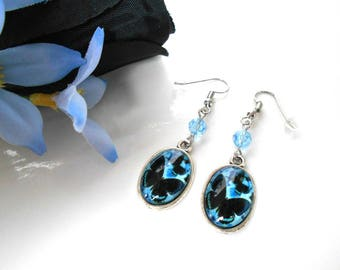 Oval cabochon with black butterflies and blue aquamarine Swarovski Crystal bead earrings
