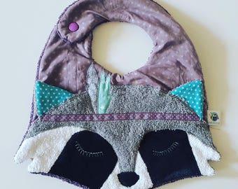 Original baby with his little raccoon bib!