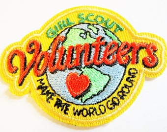"Girl Scout Fun Patch ""Volunteers Make The World Go Round"""