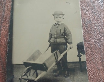 A Perfect Day for Gardening:  Unusual Antique Tintype Photograph of Young Boy Pushing a Toy Wheelbarrow