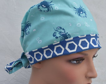 Tie Back Scrub Cap scrub hat featuring a blue material with a nautical theme with crabs and a coordinating band 2t