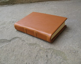 Leather journal with impressed metal foil