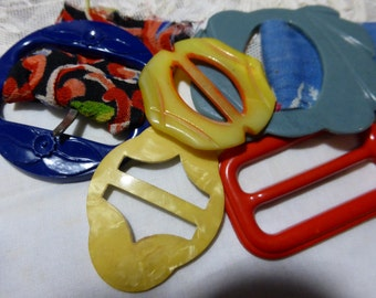 Vintage Buckles Bakelite, early plastic and Tinted Mother of Pearl group of 5.