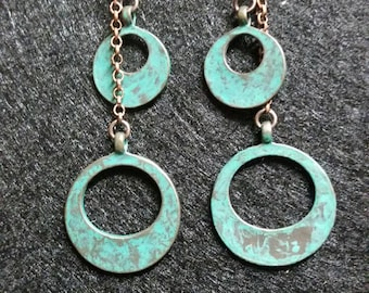 A pair of copper and teal dangle earrings