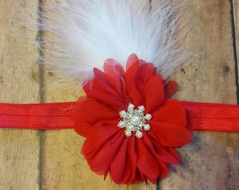 Red flower with feathers headband.