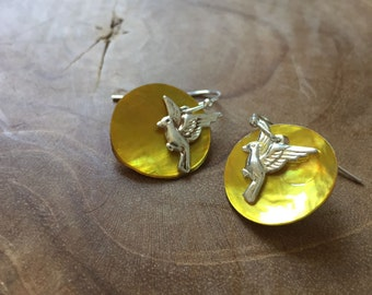 Fly - Pair of limited edition dangling earrings with yellow gold ochre mother of pearl and silvertone earhooks and flying bird charms.