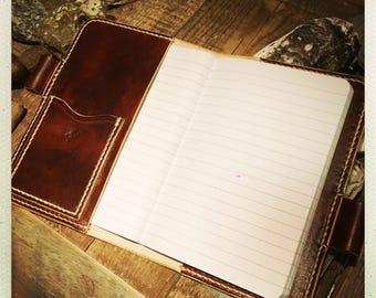 Lederen bureau onderlegger best pen en lederen notebook detail