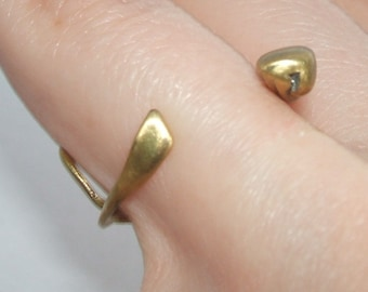 Adjustable little brass ring, like a funny animal or plant around your finger,  very raw and rustic ring, one of a kind, hand fabricated.