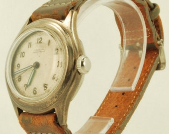 Kingston vintage wrist watch, 15 jewels, solid silver round water resistant case