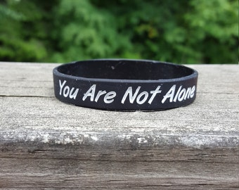 You Are Not Alone Wristband's - Leviathan Black