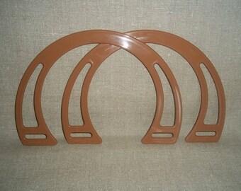 1 pair of Brown plastic handles. REF E.061