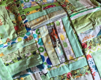 Green Flannel Baby Quilt - backside is Ducks, Balls & Blocks on green background