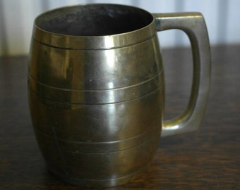 antique was silver plate now brass tankard