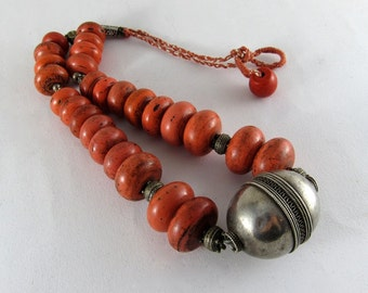 Ethnic necklace with antique silver pendant