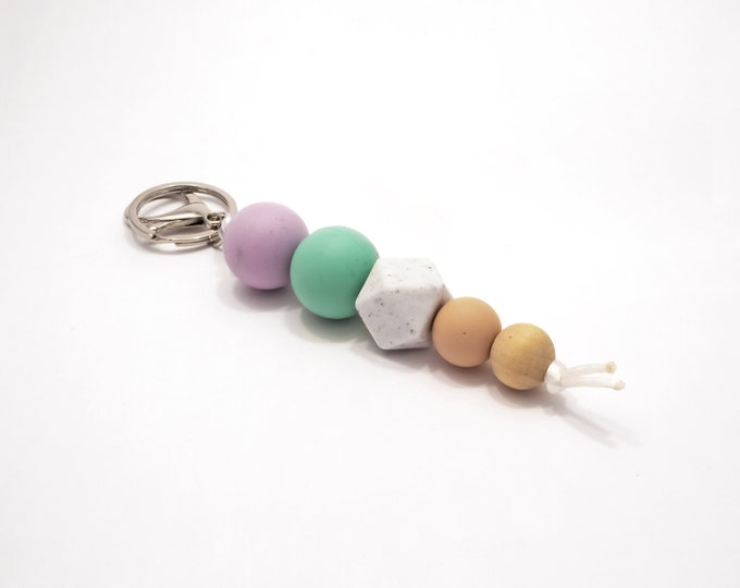 Purple, Turquoise and wood Silicone Beaded Keychain.
