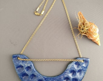 Blue ceramic statement necklace; gold chain