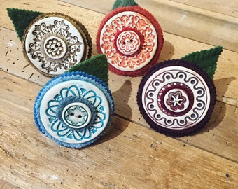 Set of four handmade ceramic button napkin rings