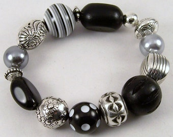 Gray Black Jumble Bracelet.. Gray and Black Chunky Wood, Resin, Pearl and Silver Plated Stretch Bracelet