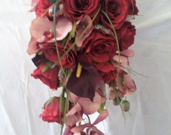 Artificial Deep Red and Plum Cascade Bridal Bouquet. Red Roses, Plum Phalenopsis Orchid, Plum calla lilly, wedding flowers
