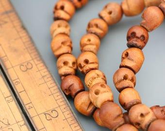 Wood skull beads. Skull bracelet. 10mm beads. Brown beaded bracelet. Beadwork, Jewelry making, Jewelry supply. DIY.