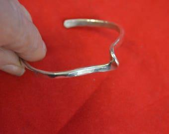 An Argentium 935 Silver Knot Cuff Bracelet.