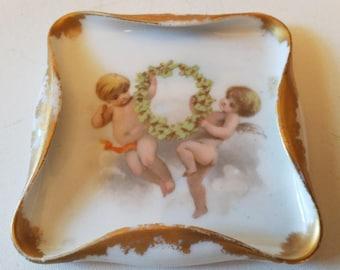 Cherubs on ceramic or porcelain tray