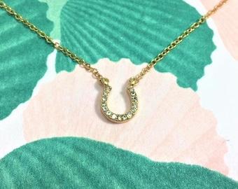 Gold horseshoe zirconia pendant necklace