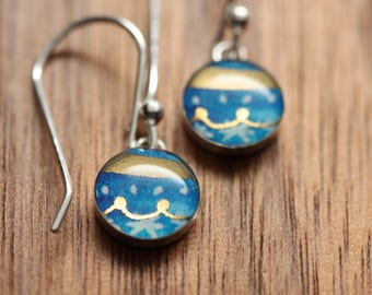 Tiny blue ornament earrings made from recycled Starbucks gift cards. sterling silver and resin.
