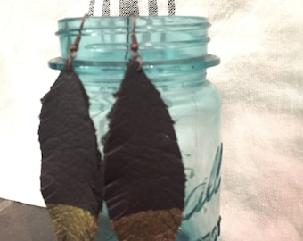 Leather feathered earrings with gold detail