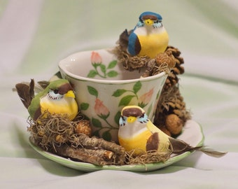 """These """"Three Little Birds"""", inspired by Bob Marley's song, are nestled in a Rosebud Teacup  waiting to perch in your home or office."""