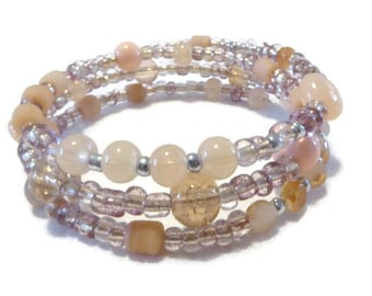Bracelet three rows beige/nude/peach and clear glass beads mixed, standard size memory wire, vintage