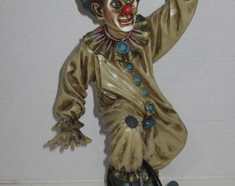 Clown Figurine riding a UniCycle